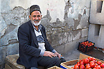 A tomato seller at the famous local bazaar, a Unesco World Heritage site (Tabriz, Iran, 2012).<br />