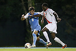 18 October 2013: North Carolina's Colton Storm (6) and Syracuse's Jordan Murrell (CAN) (4). The University of North Carolina Tar Heels hosted the Syracuse University Orangemen at Fetzer Field in Chapel Hill, NC in a 2013 NCAA Division I Men's Soccer match. UNC won the game 1-0.