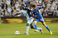 C.J Sapong (17) forward Sporting KC holds off challenge by Andrea Romero (15) forward Montreal Impact..Sporting Kansas City defeated Montreal Impact 2-0 at Sporting Park, Kansas City, Kansas.
