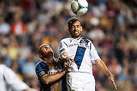 Juninho (19) of the Los Angeles Galaxy goes up for a header with Conor Casey (6) of the Philadelphia Union. The Los Angeles Galaxy defeated the Philadelphia Union 4-1 during a Major League Soccer (MLS) match at PPL Park in Chester, PA, on May 15, 2013.