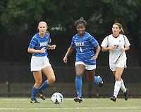 Duke University defender Natasha Anasi (4) brings the ball forward. Boston College (white) defeated Duke University (blue/white), 4-1, at Newton Campus Field, on October 6, 2013.