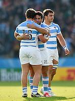 Santiago Gonzalez Iglesias of Argentina celebrates the win with team-mate Julian Montoya. Rugby World Cup Pool C match between Argentina and Tonga on October 4, 2015 at Leicester City Stadium in Leicester, England. Photo by: Patrick Khachfe / Onside Images
