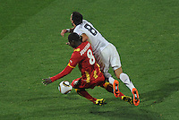 Jonathan Mensah of Ghana brings down Clint Dempsey of USA in the penalty area. Ghana defeated the USA 2-1 in overtime in the 2010 FIFA World Cup at Royal Bafokeng Stadium in Rustenburg, South Africa on June 26, 2010.