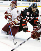Paul Carey (BC - 22), Wade MacLeod (Northeastern - 19) - The Boston College Eagles defeated the Northeastern University Huskies 5-4 in their Hockey East Semi-Final on Friday, March 18, 2011, at TD Garden in Boston, Massachusetts.