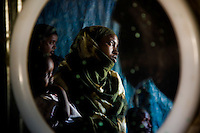 "Siida Noor Ahmed, 29 years old. Siida fled Mogadishu with 7 of her ten children and arrived  at State House IDP camp in January 2009. Her husband and 3 of her children disappeared during recent fighting in Mogadishu. .At state house she is being helped by long term resident Koos Aw Dahir with  rent, food and childcare. Koos was one of the original  residents of state house and recognized somthing of her own struggle in Siida's story..According to Siida ""I came here to get peace and to keep my children.  Three of my children went to school one day in Mogadishu.  There was fighting at the school so they ran away and got lost.  I don't know if they're alive or dead.  It's part of my body which is missing.  If only I could be told my children are dead - I could give up."".  .""Nobody normal lives in Mogadishu now - they're all abnormal.  Sometimes you see people in groups - after a few minutes a section of a person is brought back in pieces.  Sometimes people bring back the head of a friend saying 'I found a head.'""..""It's luck to eat.  People go into Mogadishu in search of casual work.  Sometimes they're given a bag to carry somewhere for 20,000 Somali shillings. But the bag is a bomb.  When they reach the destination, the person who gave it to them detonates it.""..""It was very hard to leave.  I didn't know where I was going.  My problem here is a lack of food.  How do you feel when you rely on people - when you go and ask 'have you cooked?'  Imagine how that feels if you've been working before.  We feel like we're becoming a problem to the neighbours.""..""But we're happy because we have peace, people here have given us a house and the lady next door is helping me.""  ."