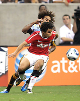 Kevin Alston #30 of the MLS All-Stars is blocked off the ball by Fabio #20 of Manchester United during the 2010 MLS All-Star match at Reliant Stadium, on July 28 2010, in Houston, Texas. MANU won 5-2.