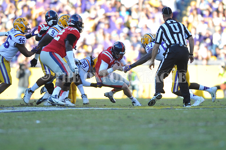 Ole Miss quarterback Bo Wallace (14) vs. LSU defensive end Lavar Edwards (89) and LSU linebacker Lamin Barrow (57) at Tiger Stadium in Baton Rouge, La. on Saturday, November 17, 2012.....