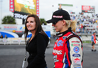 Mar. 10, 2012; Gainesville, FL, USA; NHRA funny car driver Courtney Force (right) with mother Laurie Force during qualifying for the Gatornationals at Auto Plus Raceway at Gainesville. Mandatory Credit: Mark J. Rebilas-