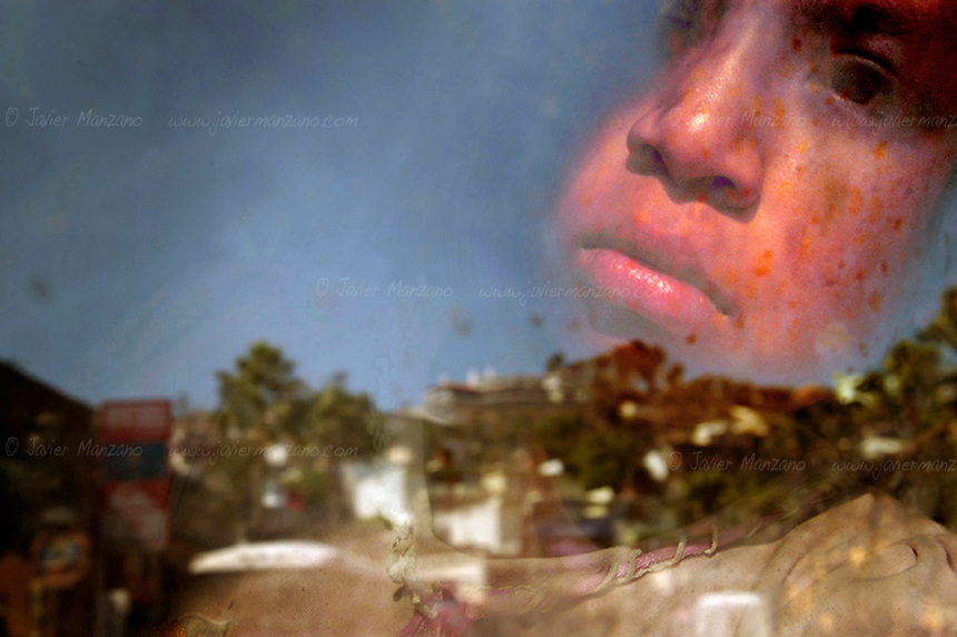 A twelve-year-old Mixteco girl looks out the window of the DIF (Integral Family Development) worker?s van, as she was picked up by DIF social workers to prevent her from selling arts and crafts to the tourists of Ensenada Mexico. Child labor is viewed by the city officials as something bad for tourism, tainting the image of this sunny port-town. As a consequence, they attempt to clean the city by rounding up these children and taking them to a small school where they are fed and allowed to roam for a few hours until it?s time for them to go home with their mothers. The loss of income that these families endure because of the implementation of this program far outweighs the benefits of a free meal for some. Moreover, some of these children suffer severe beatings for not working as part of the family economy. ..For most of them, life is split between two countries. On the one side, most of them live with their single mothers, as immigration to the United States has become the common denominator for these internal migrants. On the other, they rely on the dollars that tourists bring to their local economies, making this a strange but necessary symbiosis. ..Ensenada, Mexico. 09/12/04