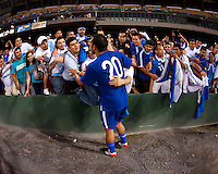 Carlos Ruiz (20) of Guatemala (20) celebrates with fans at RFK Stadium in Washington, DC.  Guatemala tied Paraguay, 3-3.