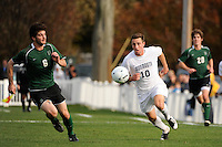 Ryan Kinne (10) of the Monmouth Hawks is chased by Bryan Giudicelli (6) of the Dartmouth Big Green. Dartmouth defeated Monmouth 4-0 during the first round of the 2010 NCAA Division 1 Men's Soccer Championship on the Great Lawn of Monmouth University in West Long Branch, NJ, on November 18, 2010.
