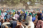 At the weekly cattle market in the town of Djibo in northern Burkina Faso, Fulani herders negotiate the purchase and sale of livestock.  The Fulani are traditionally nomadic pastoralists, crisscrossing the Sahel season after season in search of fresh water and green pastures for their cattle and other livestock.