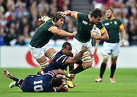 Eben Etzebeth of South Africa takes on the USA defence. Rugby World Cup Pool B match between South Africa and the USA on October 7, 2015 at The Stadium, Queen Elizabeth Olympic Park in London, England. Photo by: Patrick Khachfe / Onside Images