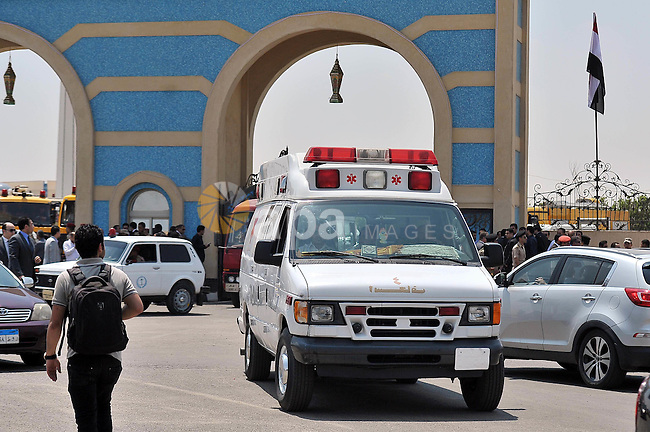 An Ambulance carring the body of Hisham Barakat, the top judicial official in charge of overseeing the prosecution of thousands of Islamists, including former President Mohammed Morsi, arrives to the Hussin Tantawy Mosque, in Cairo, Egypt, Tuesday, June 30, 2015. The Egyptian president promised to speed up proceedings against extremists by amending laws and freeing up the judiciary, a day after the country s top prosecutor was killed in a car bombing. Photo by Amr Sayed