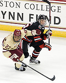 Quinn Smith (BC - 27), Kevin Roy (NU - 15) - The Boston College Eagles defeated the visiting Northeastern University Huskies 3-0 after a banner-raising ceremony for BC's 2012 national championship on Saturday, October 20, 2012, at Kelley Rink in Conte Forum in Chestnut Hill, Massachusetts.