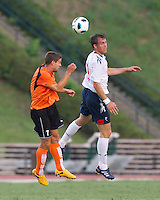 Johan Elmander (BW) and Chris Lemmons (CE) contest a header.  The Charlotte Eagles currently in 3rd place in the USL second division play a friendly against the Bolton Wanderers from the English Premier League.