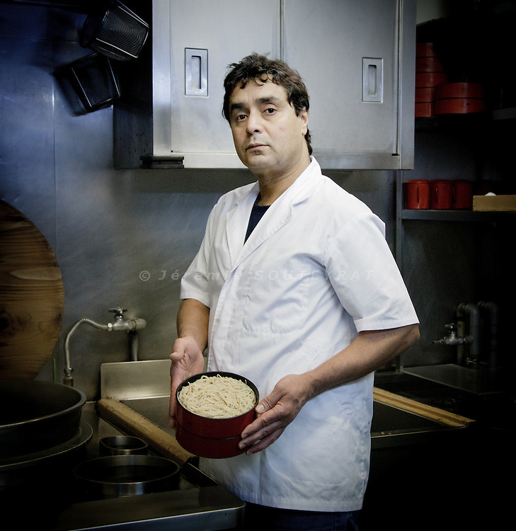 Kawasaki, Januray 12 2011 - Algerian chef Belouazani Lakhdar in his Japanese noodles (soba) restaurant near Tokyo. He's been making soba noodles for 17 years in the area and appears to be the only foreigner in the world to cook soba noodles. M. Lakdhar posing with the soba that he just prepared.
