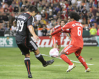 Jaime Moreno #99 of D.C. United kicks the ball against the arm of Julian de Guzman #6 of Toronto FC which resulted in a penalty kick for D.C. during an MLS match that was the final appearance of D.C. United's Jaime Moreno at RFK Stadium, in Washington D.C. on October 23, 2010. Toronto won 3-2.