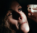 (11-16-00) COAHUILA, MEXICO--A SECTION--Ocularist Don Kluge compares the size and color of an artificial eye to the good eye of Maria Angelica Macias, 25, of San Luis Rio Colorado in Mexico, during a fitting in a dental clinic in Coahuila. STAFF PHOTO BY Rodrigo Peña.