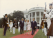 First lady Pat Nixon shares a private thought with Vice President Gerald R. Ford as she and United States President Richard M. Nixon walk to Marine 1 on the South Lawn of the White House following Nixon's farewell statement to his staff in the East Room of the White House on August 9, 1974 after he resigned as President. <br /> Credit: White House via CNP