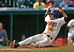 14 September 2008: Cleveland Indians' infielder Jamey Carroll tags up and slides home safely to score Cleveland's second run on a Victor Martinez fly-ball sacrifice to left field in the first inning against the Kansas City Royals at Progressive Field in Cleveland, Ohio. The Royal defeated the Indians 13-3 to take the 4-game series three games to one...Mandatory Photo Credit: Ed Wolfstein Photo