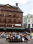 Shoppers sitting outside the famous historic  t'Goude Hoft, or Golden Head restaurant, The Hague