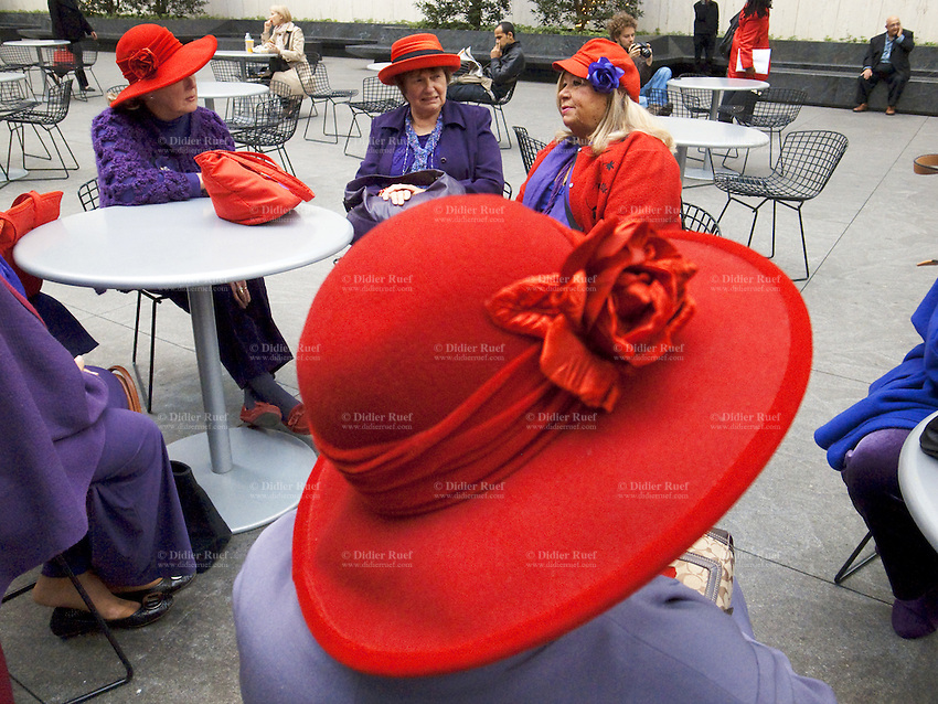 USA. New York City. A group of elderly women, all wearing a red hat