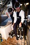 "Harumiya Co. staff Natsumi Takagi (l) and Kaoruku Mano stock up on beer for an evening aboard a ""Yakata-bune"" pleasure boat run by the Yasuda family in Tokyo, Japan on 30 August  2010. Photographer: Robert Gilhooly"