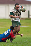 Sami Soane gets tackled around the anles by Cameron Bell. Counties Manukau Premier Club Rugby game between Manurewa and Ardmore Marist played at Mountfort Park, Manurewa on Saturday June 19th 2010..Manurewa won the game 27 - 10 after leading 15 - 5 at halftime.