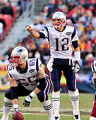New England Patriots quarterback Tom Brady (12) directs the offense  in the game against the Washington Redskins at FedEx Field in Landover, Maryland on Sunday December 11, 2011.  The Patriots won the game 34 - 27..Credit: Ron Sachs / CNP.(RESTRICTION: NO New York or New Jersey Newspapers or newspapers within a 75 mile radius of New York City)
