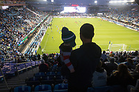 SAN JOSE, CA - March 24, 2017: A dad and his child view the pregame activities inside Avaya Stadium before the CONCACAF World Cup Qualifier game between the USA and Honduras.