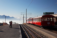 Red cog rail train car on summit of Mount Rigi, Switzerland, Europe