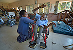 Innocent Chikomo, 17, is a student at the Jairos Jiri School in Harare, Zimbabwe. He uses a wheelchair provided by the Jairos Jiri Association with support from CBM-US. Here he gets the padding in his wheelchair adjusted by Miriam Phiri, a staff member of the school.