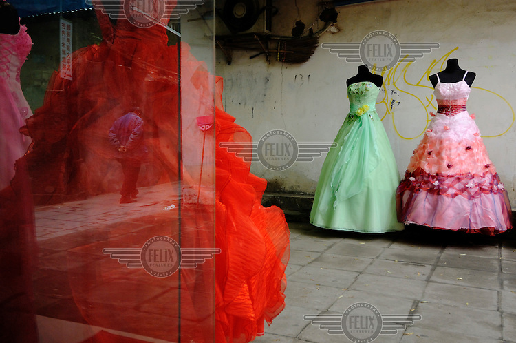 Wedding dress shop. Part of a new trend of people who are buying their wedding dresses rather than hiring them.