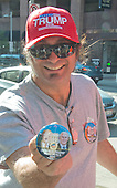 Tino Ferreira, a vendor from Sarasota, Florida, displays his latest piece of Donald Trump merchandise, that he says he received earlier in the day near the Quicken Loans Arena, site of the 2016 Republican National Convention in Cleveland, Ohio on Saturday, July 16, 2016.<br /> Credit: Ron Sachs / CNP<br /> (RESTRICTION: NO New York or New Jersey Newspapers or newspapers within a 75 mile radius of New York City)