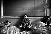 Wroclaw 02.02.2007 Poland.<br /> Mariusz Kozuchowski,4 in his room.<br /> Clinical Hospital, oncology and haematology departmend. This is one of the important Haematologic Hospital in all over Poland, however hospital board stopped to discharge a rising debt. In this connection authorities must close hospital, but goverment had no idea what should do with terminaly ill children.<br /> (Photo: Adam Lach / Napo Images)<br /> <br /> Akedemicki Szpital Kliniczny, oddzial onkologii i hematologii. Temu jednemu z najwazniejszych w Polsce osrodkowi szpitalnemu grozi zamkniecie w powodu dlugow, ktore niezaleznie od wplat NFZ-tu regularnie sciaga komornik. Z calej Polski ludzie charytatywnie wplacaja pieniadze by uratowac szpital i los dzieci dla ktorych to miejsce jest jedynym ratunkiem.