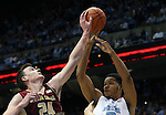 30 January 2016: Boston College's Dennis Clifford (24) blocks a pass by North Carolina's Kennedy Meeks (3). The University of North Carolina Tar Heels hosted the Boston College Eagles at the Dean E. Smith Center in Chapel Hill, North Carolina in a 2015-16 NCAA Division I Men's Basketball game. UNC won the game 89-62.