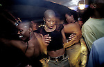 Unidentified young black yuppies dance and party at Who's Zoo, a popular nightclub on June 6, 2002 in Forways, an affluent suburb in Johannesburg, South Africa. After more than a decade democracy, a new black middleclass and elite is growing rapidly, and they have money to spend on houses, cars and entertainment. (Photo: Per-Anders Pettersson)..