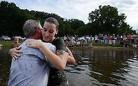 NWA MEDIA SAMANTHA BAKER @NWASAMANTHA<br /> Pastor Ron Carter hugs Lisa Fabrizio after she is baptized Sunday, July 27, 2014, at Lake Avalon during Bella Vista Christian Church's baptizing event.