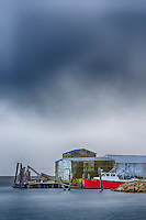 Red boat with a approaching storm at Wanchese harbor Outer Banks NC.
