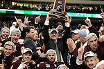 09 APR 2011: University of Minnesota Duluth coach Scott Sandelin lifts the championship trophy after defeating the University of Michigan in overtime to win the Division I Men's Ice Hockey Championship held at the Xcel Energy Center in St. Paul, MN. Minnesota-Duluth beat Michigan in overtime, 3-2 to claim the national title. Vince Muzik/ NCAA Photos