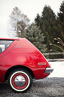 Reinholds, Pennsylvania, February 10, 2015 - A detail of the back half of Brian Moyer's 1971 Base Model AMC Gremlin in matador red. Moyer restored the car over 20 years ago. <br /> <br /> Moyer owns 16 AMC Gremlins. The Gremlin was introduced on April Fools Day (April 1) in 1970 featuring a shortened Hornet body with a Kammback tail and was manufactured in the US via AMC and in Mexico via AMC's subsidiary VAM. It's lifecycle ended in 1978 when it was replaced by the AMC Spirit. Moyer became interested as a kid when he saw the early Gremlin commercials in 1970. His first car was a Gremlin and he has never not owned one. Today he has arguably the most unique collection of Gremlins in the world, including several that are one-of-a kind models. <br /> <br /> CREDIT: Daryl Peveto for The Wall Street Journal<br /> Photo Assignment ID: 36892 <br /> Slug: MYRIDE_Gremlin