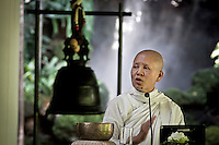 MAE CHEE SANSANEE STHIRASUTA speechs to an audience of lay female Buddhists during a Dharma's course given in Sathira Dhammasathan meditation centre. SANSANEE is a Buddhist leader nun and the Founder/Director of Sathira-Dhammasathan Center located at the outskirts of Bangkok. At the age of 27 she renounced to wealthy and her worldly position as a supermodel to take ordination as a Buddhist nun and started to study the path of Buddhist teachings. SANSANEE has been recognized internationally by her efforts to bring peace, harmony and respect using Dharma's speech. She has been pointed as one of the ten most influential women in Thailand.