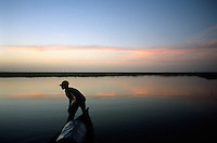 Boatman Atraman Maika watches the channel of the river from the bow of a pinasse on the Niger River, Jan. 4, 2008.