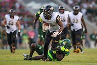 Tampa, FL - September 2, 2016: Towson Tigers wide receiver Andre Dessenberg (18) breaks a tackle of a USF defender during game between Towson and USF at the Raymond James Stadium in Tampa, FL. September 2, 2016.  (Photo by Elliott Brown/Media Images International)