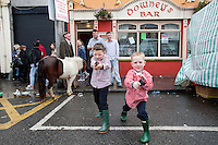 4/10/2010.  Traveller boys play with toy guns outside Downeys Bar during the Ballinasloe Horse Fair, Ballinasloe, County Galway, Ireland. Picture James Horan.