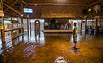 SAINT MARKS, FL - SEPTEMBER 01:Brian Mugrage watches the weather on TV inside the Riverside Cafe flooded by the storm surge from Hurricane Hermine on September 1, 2016 in Saint Marks, Florida.  Hurricane warnings have been issued for parts of Florida's Gulf Coast as Hermine is expected to make landfall as a Category 1 hurricane (Photo by Mark Wallheiser/Getty Images)