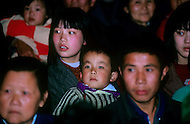 April 15th, 1989, Poyang, Jiangxi Province, China. Audience watching a traveling opera troupe  perform.