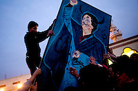 A crowd of a couple of hundred people gathered in the central square of Tobruk shouting anti Gaddafi slogans while destroying a portrait of him. On 17 February the country saw the beginnings of a revolution against the ruling Col Muammar Al Gaddafi. Rebels now seem to control Tobruk after a pivotal attack on the city's police station. In total between 150 and 200 civilians have been killed in violence during the uprising in this area alone.
