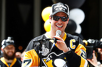 Sidney Crosby #87 of the Pittsburgh Penguins speaks on stage during the Stanley Cup victory parade in downtown Pittsburgh, Pennsylvania on June 15, 2016. (Photo by Jared Wickerham / DKPS)